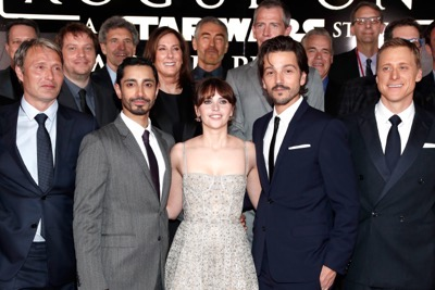 "HOLLYWOOD, CA - DECEMBER 10: (L-R front row) Actors Mads Mikkelsen, Riz Ahmed, Felicity Jones, Diego Luna and Alan Tudyk (back row) Director Gareth Edwards, Chairman, The Walt Disney Studios, Alan Horn, Producer Kathleen Kennedy, Actor Ben Mendelsohn and Executive producer Jason McGatlin attend The World Premiere of Lucasfilm's highly anticipated, first-ever, standalone Star Wars adventure, ""Rogue One: A Star Wars Story"" at the Pantages Theatre on December 10, 2016 in Hollywood, California.  (Photo by Rich Polk/Getty Images for Disney) *** Local Caption *** Mads Mikkelsen; Riz Ahmed; Felicity Jones; Diego Luna; Alan Tudyk; Gareth Edwards; Alan Horn; Kathleen Kennedy; Ben mendelsohn; Jason McGatlin"