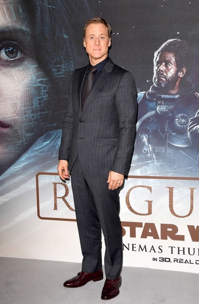 "Alan Tudyk attends the launch event and reception of Lucasfilm's highly anticipated, first-ever, standalone Star Wars adventure, ""Rogue One: A Star Wars Story"" at the Tate Modern on Tuesday December 13, 2016 in London, UK."