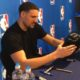 Klay Thompson signing a toaster autograph 1