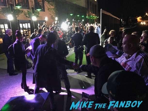 John Cho signing autographs Oscar Wilde green carpet signing autographs for fans 23