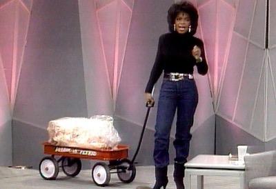 Oprah winfrey wheeling her fat across the stage