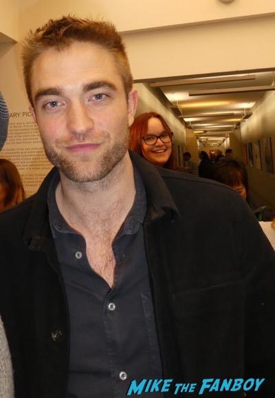 Robert Pattinson meeting fans signing autographs 7