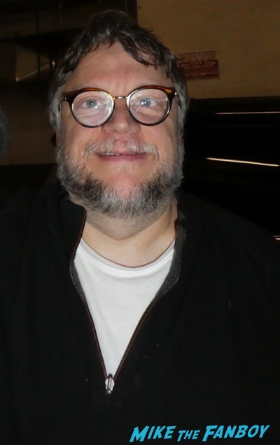 Guillermo del Toro with fans signing autographs 1