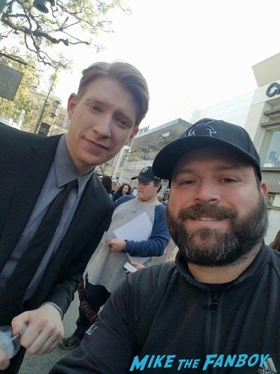 Domhnall Gleeson with fans signing autographs