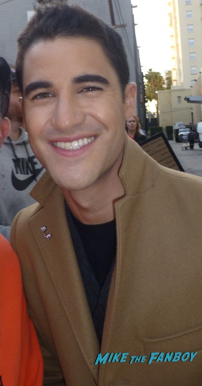 Darren criss with fans signing autographs