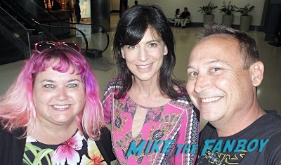 Perrey Reeves with fans signing autographs