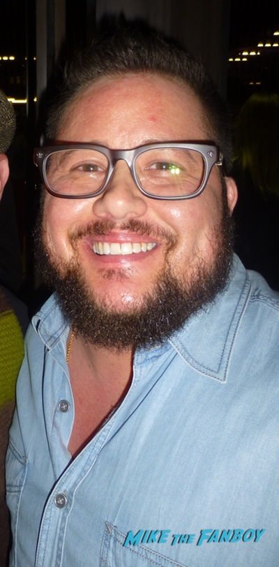 Chaz Bono with fans signing autographs