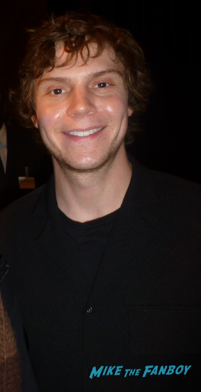 Evan Peters with fans signing autographs