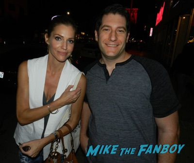 Tricia Helfer with fans signing autographs