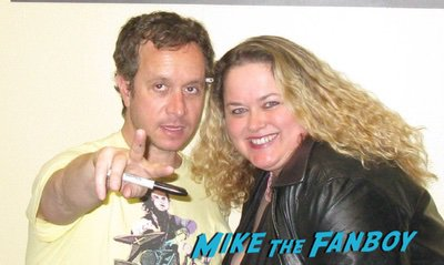 Pauley Shore with fans signing autographs