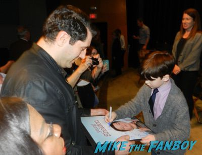 Iain Armitage with fans signing autographs