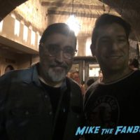 Alfred Molina with fans signing autographs