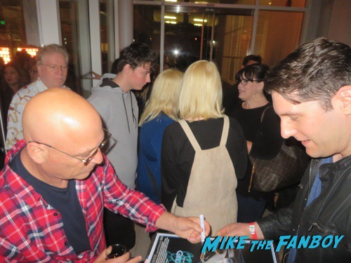 Howie Mandel with fans signing autographs