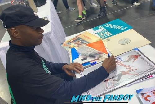 Michael Chambers with fans signing autographs