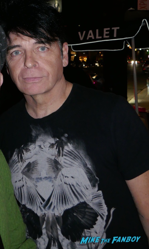 Gary Numan with fans signing autographs