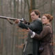 Richard Rankin as Roger MacKenzie and Sophie Skelton as Brianna Fraser MacKenzie - Outlander Season 5 Episode 2
