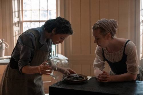 Caitriona Balfe as Claire Fraser and Lauren Lyle as Marsali