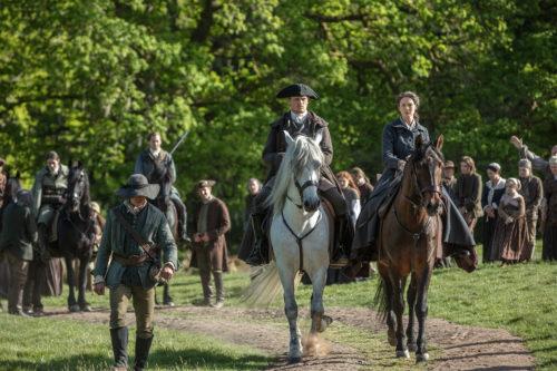 Sam Heughan as Jamie Fraser, Caitriona Balfe as Claire Fraser and Richard Rankin as Roger MacKenzie