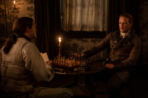 Sam Heughan as James Fraser and Michael D. Xavier as Lieutenant Knox