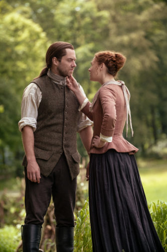 Richard Rankin as Roger MacKenzie and Sophie Skelton as Brianna MacKenzie courtesy of Starz